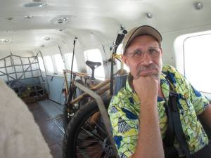 Chuck on the plane headed back to Kinshasa with a just completed transport bike ready to be taken to other parts of Congo for demonstration.