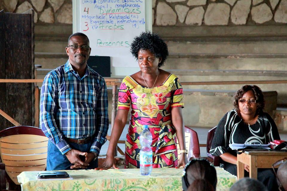 Rev. Mundedi Berci shared her journey into leadership. Leonard Kiswangi translated into Gipende. Antoinette sat in the background.